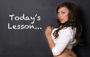 Today's Lesson written on a black board with a sexy teacher standing next to the text