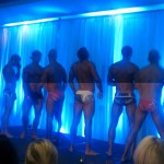 Men standing on stage in their underwear for the underwear charity auction